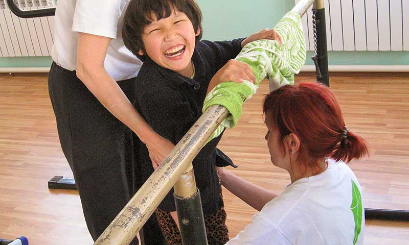 Happy Kyrgyz child in physiotherapy
